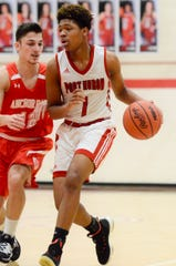 Port Huron's De'Ovion Price dribbles against Anchor Bay during a boys basketball game on Friday, Jan. 3, 2020, at Port Huron High School.