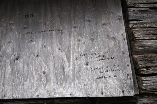 Writings left on a cabin near where a cross was damaged on Honness Mountain off Interstate 84 in Fishkill Jan. 3, 2020. The cross was taken down by vandals on Thursday, owner said.