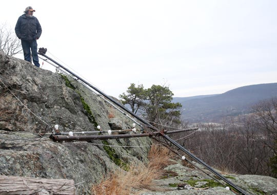 James A. Brooks look over the cross that once stood on Honness Mountain off Interstate 84 in Fishkill Jan. 3, 2020. The cross was taken down by vandals on Thursday, he said.