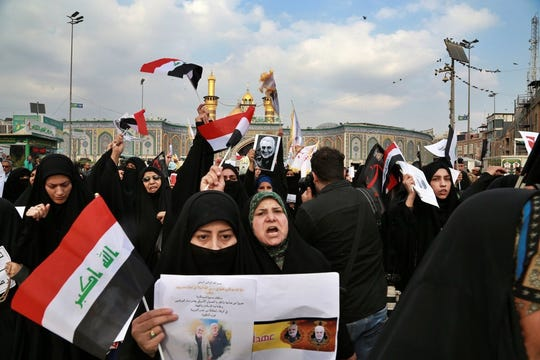 """Shiite Muslims demonstrate over the U.S. airstrike that killed Iranian Revolutionary Guard Gen. Qassem Soleimani, in the posters, in Karbala, Iraq, Saturday, Jan. 4, 2020. Iran has vowed """"harsh retaliation"""" for the U.S. airstrike near Baghdad's airport that killed Tehran's top general and the architect of its interventions across the Middle East, as tensions soared in the wake of the targeted killing.  Photo by Khalid Mohammed"""