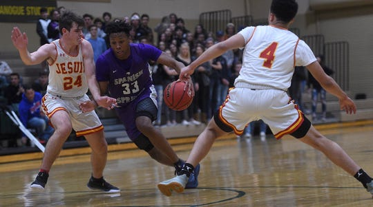 Spanish Springs' Cordell Stinson (33) drives towards the basket while taking on Jesuit (Calif.) on Dec. 6, 2019.