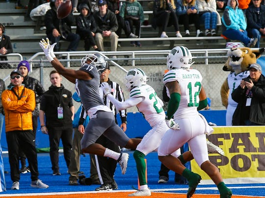 Nevada Wolf Pack wide receiver Justin Lockhart (17) attempts to catch a pass in the end zone during the first half of the Famous Idaho Potato Bowl against the Ohio Bobcats  at Albertsons Stadium.