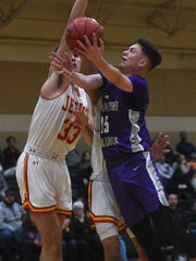 Spanish Springs' Mason Whittaker (15) drives to the basket while taking on Jesuit (Calif.) on Dec. 6, 2019.