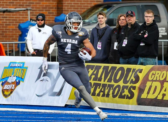 Nevada wide receiver Elijah Cooks runs for extra yardage during the first half of the Famous Idaho Potato Bowl against Ohio.