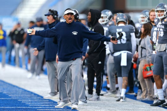 Nevada head coach Jay Norvell tries to get the attention of an official during the second half of the Famous Idaho Potato Bowl on Friday.