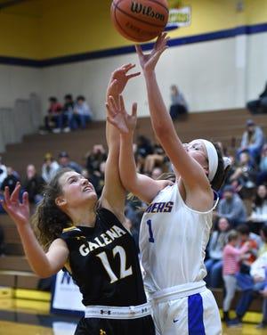 Emma Johnson shoots during a girls basketball game last season.