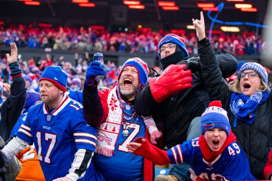 ORCHARD PARK, NY - NOVEMBER 24:  Buffalo Bills fans celebrate a review resulting in a touchdown for the Buffalo Bills during the fourth quarter against the Denver Broncos at New Era Field on November 24, 2019 in Orchard Park, New York. Buffalo defeats Denver 20-3.  (Photo by Brett Carlsen/Getty Images)