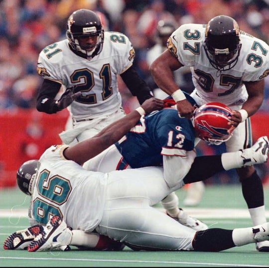 Jim Kelly suffered a concussion on this play in the 1996 playoff loss to the Jaguars in what proved to be his final NFL game.
