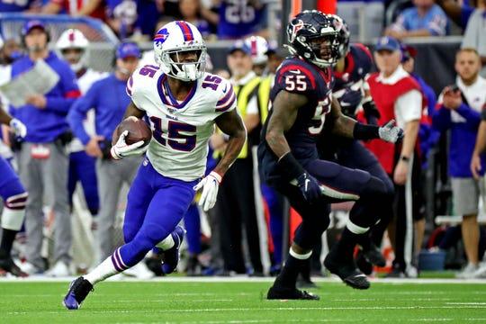 Buffalo Bills wide receiver John Brown (15) runs the ball against Houston Texans inside linebacker Benardrick McKinney (55) during the second quarter in the AFC Wild Card NFL Playoff game at NRG Stadium.