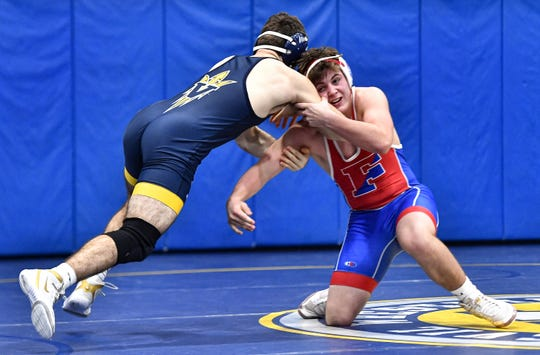 Fairport's Patrick Unger, right, wrestles Victor'ss Benji Abreu in the 160-pound weight class during the annual Ahonen Duals meet at Victor High School, Saturday, Jan. 4, 2020.
