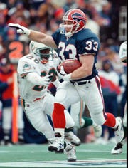 Tim Tindale breaking away for a 44-yard TD run against Miami in the 1995 wild-card game.