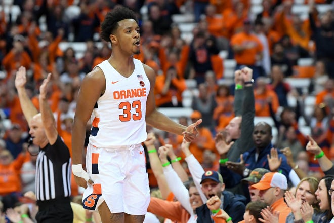 Syracuse Orange forward Elijah Hughes (33) reacts to a made three-point basket against the Notre Dame Fighting Irish during the first half at the Carrier Dome.
