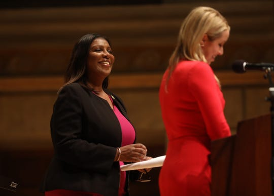 New York State Attorney General Letitia James smiles after her introduction by Jennifer Johnson, the master of ceremony, during the inauguration.