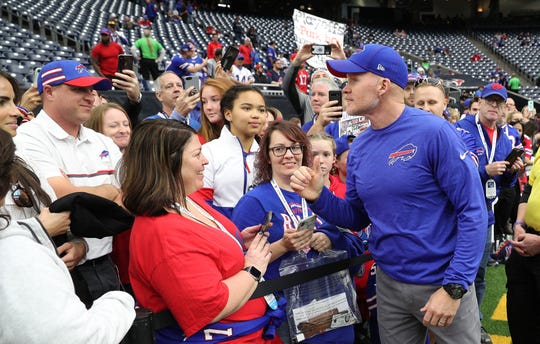 """Bills head coach Sean McDermott greets fans before Saturday's wild-card game in Houston. He called the 22-19 overtime loss 'painful' but he said it's important to use the experience in the proper way. """"I don't' think you ever get over those memories but I believe this: winners know how to turn that pain into growth. That's what I've done personally and it's what I've told the team, that we'll never stop fighting. That's been my career to this point and I expect that the Buffalo Bills to never stop fighting.''"""