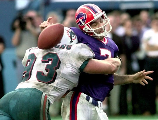 Miami's Trace Armstrong nails Doug Flutie and forces a fumble that secured the Dolphins playoff victory over Buffalo after the 1998 season.
