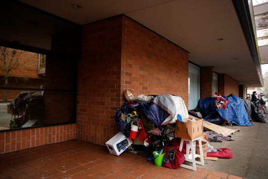 People keep belongings on the north side of the former Nordstrom in downtown Salem on Jan. 2, 2020. A city ordinance doesn't allow tents to be set up, but people can currently sleep on sidewalks.