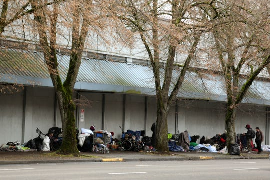 People keep belongings on the west side of the Rite Aid in downtown earlier this year. Salem officials recently dispersed congregations of homeless individuals to reduce the spread of coronavirus.