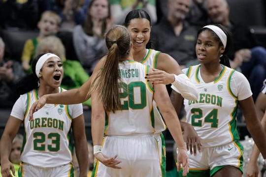Oregon's Minyon Moore, Sabrina Ionescu, Satou Sabally and Ruthy Hebard, from left, celebrate a play during the third quarter of the team's NCAA college basketball game against Colorado in Eugene, Ore., Friday, Jan. 3, 2020. (AP Photo/Chris Pietsch)