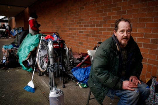Brian Jackman, 56, sits near his sleeping spot on the north side of the former Nordstrom in downtown Salem on Jan. 2, 2020. A city ordinance doesn't allow tents to be set up, but people can currently sleep on sidewalks.