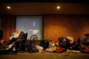 People and belongings are lined up along the north side of the former Nordstrom in downtown Salem on Jan. 3, 2020.
