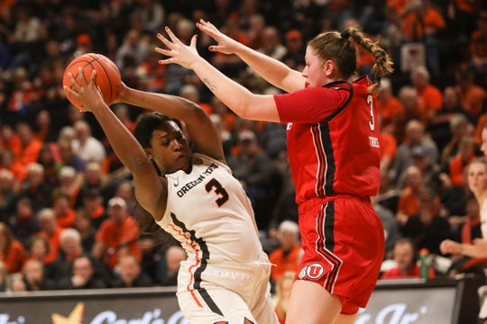 Oregon State's Madison Washington, left, tries to evade Utah's Andrea Torres, right, during the first half of an NCAA college basketball game in Corvallis, Ore., Friday, Jan. 3, 2020.