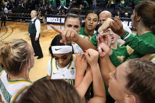 Oregon players gather at mid ourt after defeating Colorado 104-46 in an NCAA college basketball game in Eugene, Ore., Friday, Jan. 3, 2020. (AP Photo/Chris Pietsch)