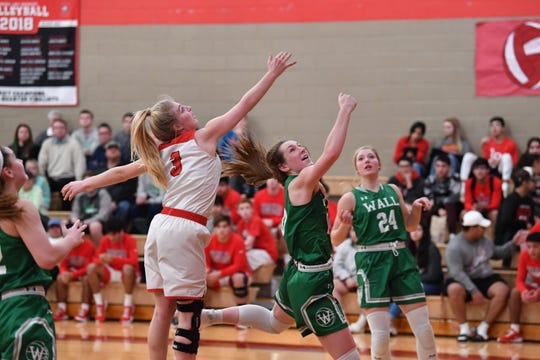 Sonora's Brae Lynn Harris (3) goes up to try and block a layup attempt by Wall's Falyn Guy (10) during a District 4-3A girls basketball game Friday, Jan. 3, 2020, in Sonora.