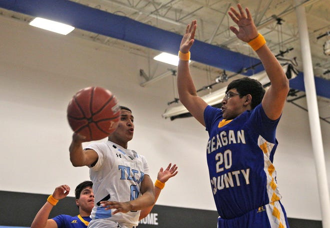 Jevon Everitt, left, passes the ball for TLCA during a game against Reagan County on Friday, Jan. 3, 2020.