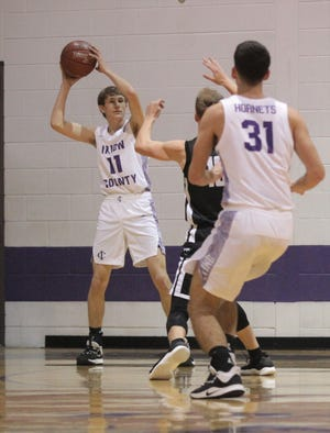 Irion County's Dawson Sparks (11) looks to pass inside to teammate Milot Morina (31) during a District 11-1A boys basketball game against Water Valley Friday, Jan. 3, 2020, at Irion County's Estes Gym in Mertzon.