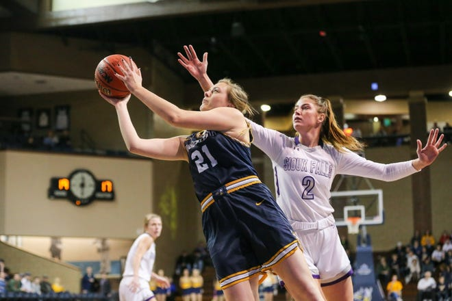 Augustana's Hannah Mitby goes up for a shot as USF's Anna Goodhope defends during Saturday's rivalry game at the Pentagon.