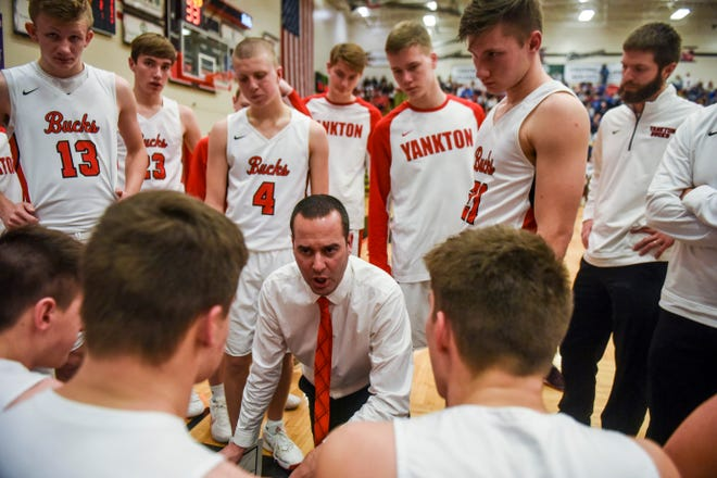 Head coach Chris Haynes goes over plays with Yankton during the game against O'Gorman on Friday, Jan. 3, 2020 at Yankton High School.