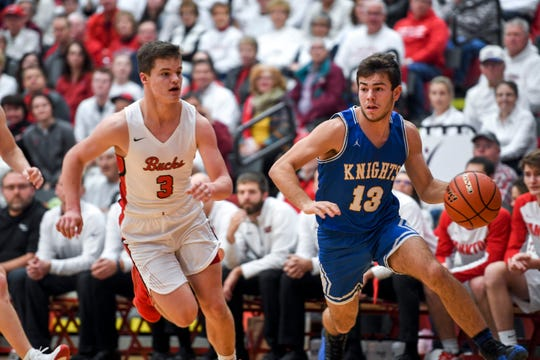 O'Gorman's Zach Norton (13) drives to the basket during the game against Yankton on Friday, Jan. 3, 2020 at Yankton High School.