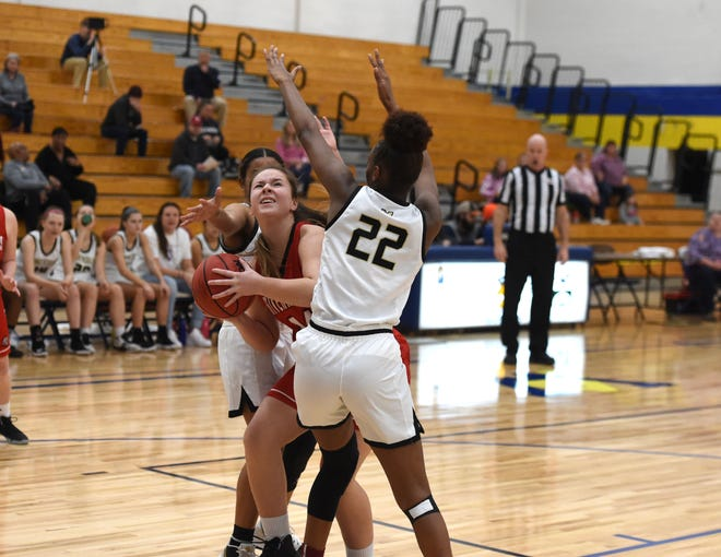 Riverheads' Berkeley Tyree goes between a pair of Monticello defenders at the Play for Preemies Showcase Saturday, Jan. 4.