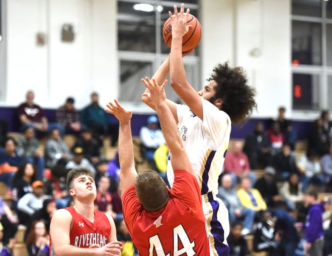 Waynesboro's Damien Fisher puts up a shot Friday against Riverheads.