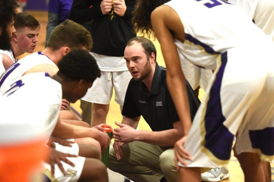 Waynesboro assistant coach Alex Graves talks to the team during a timeout Friday night.