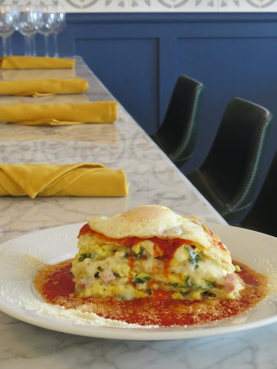 Breakfast lasagna topped with a fried egg is on the menu at Immigrant Son Caffe in Ventura.