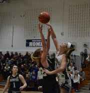 Brewster forward Alexis Mark (22) gets to the line after drawling a foul against Putnam Valley forward Arianna Stockinger during the second half of a Tigers' win on Jan. 3, 2020 at Putnam Valley High School.