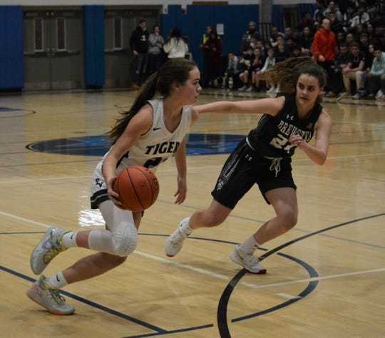 Putnam Valley guard Eva DeChent pushes the ball in transition against Brewster forward Madison Dakin. DeChent helped the Tigers improve to 6-2 with a game-high 22 points  on Jan. 3, 2020 at Putnam Valley High School.