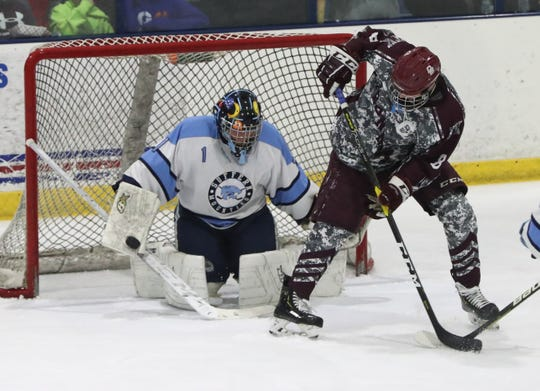 Suffern goalie Jared Packman stops a shot by Don Bosco's Hunter McGee during their game at Sport-O-Rama Jan. 3, 2020. Suffern won 5-3.