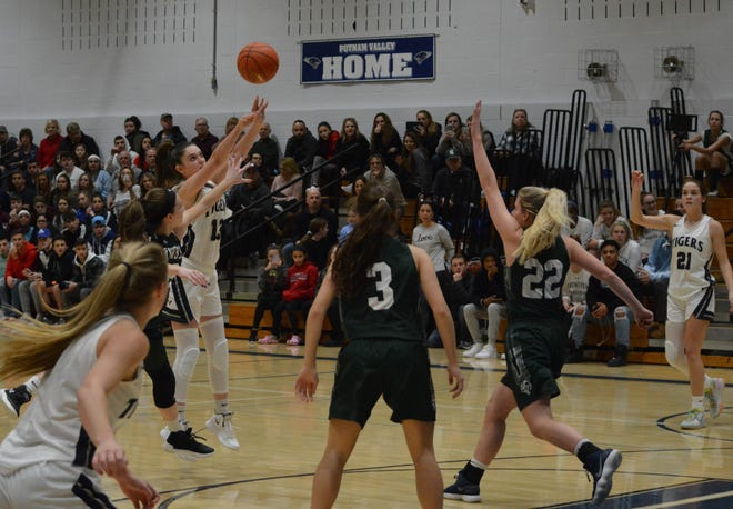 Putnam Valley guard Kelli Venezia (13) steps into a seam and drops a second-quarter 3 as Brewster guard Carly Delanoy (12) closes out. Venezia surpassed 1,000 career points in the Tigers' 64-43 win on Jan. 3, 2020 at Putnam Valley High School.