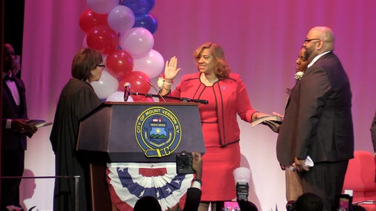 Mount Vernon Mayor Shawyn Patterson-Howard, center, takes the oath of office from Hon. Kathie E. Davidson as her husband Marvin holds then bible, during her Inauguration at Nellie A. Thornton High School in the city, Jan. 4, 2020.