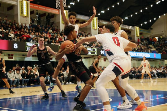 Iona's Ethan Robinson (2) pulls down a a rebound in front of Stepinac's Justin Morety (0) during the 3rd annual Crusader Classic at the Westchester County Center in White Plains Jan. 3, 2020.