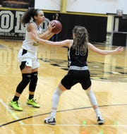 Rider's Jaelynn White (left) looks to pass while guarded by Alvord's Tawni Hamilton in non-district action Friday, Jan. 3, 2020, at Rider Fieldhouse.