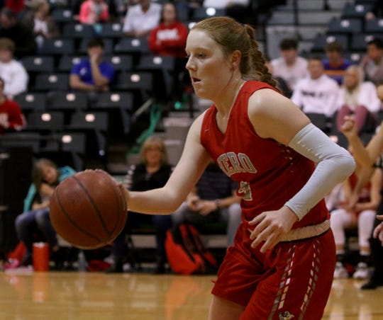 Holliday's Sarah Cowan dribbles in the game against Iowa Park Friday, Jan. 3, 2020, in Iowa Park.