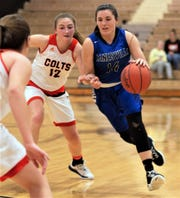 Zanesville's Aayla Mayle drives past Meadowbrook's Elena Bell on the way to the basket. The Lady Devils won 58-24.