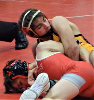 New Lexington senior Blake Sheppard wrestles Utica freshman Clayton Smith in a 113-pound semifinal during Saturday's Licking Valley's Invitational.