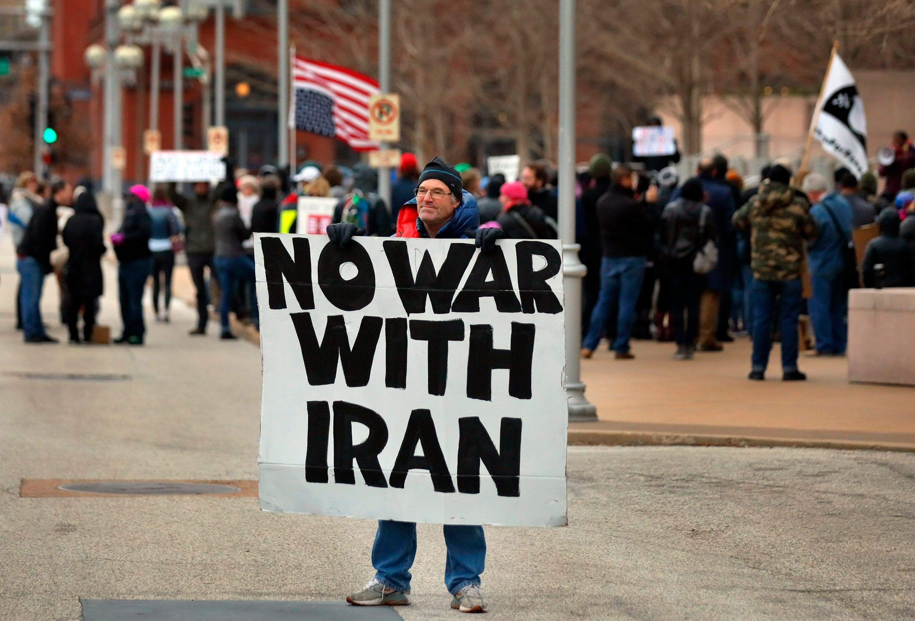 Air Force veteran Mike Fitzgerald stands near an anti-war protest outside the Federal Courthouse in St. Louis.