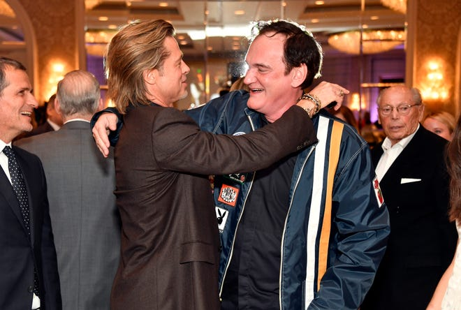"""Once Upon a Time in Hollywood"" star Brad Pitt and his director Quentin Tarantino reunited at Friday's AFI Awards."