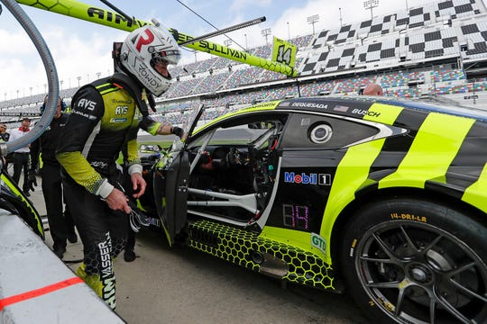 Kyle Busch climbs in his car during testing for the Rolex 24 at Daytona on Jan. 3, 2020.