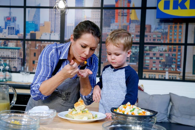 Dylan Dreyer and son Calvin Bradley Fichera prepare a dish onstage for a culinary demonstration during the Grand Tasting presented by ShopRite featuring Culinary Demonstrations at The IKEA Kitchen presented by Capital One at Pier 94 on October 13, 2019 in New York City.